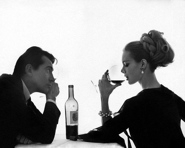 """Walter Chiari et Monique Chevalier sharing a bottle of Chateau Lafite-Rothschild"" Bert Stern (1962)"